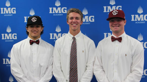 Fletcher's Logan Allen, far right, and two of his IMG