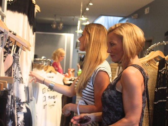 Friends shop together at a Girls' Night Out event in