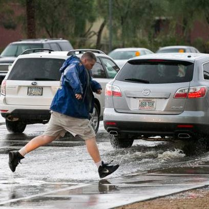 Jeff Emery of Tempe jumps over a pool of water across