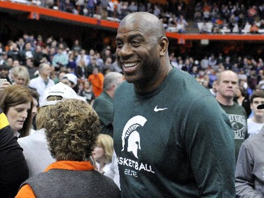 Magic Johnson cheers for the Spartans.