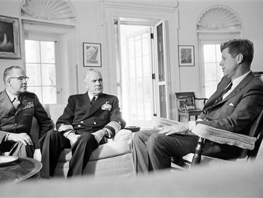 "The 1962 Cuban Missile Crisis was the basis for the film ""Thirteen Days."" Here, In this Oct. 29, 1962, file photo, President John F. Kennedy poses in the White House office with Gen. David Shoup, left, Marine Corps Commandant, and Adm. George Anderson, Chief of U.S. Naval Operations in Washington."