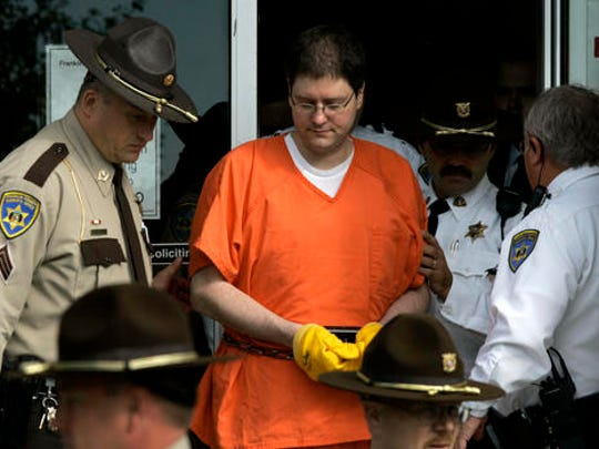 In this Oct 8, 2007 file photo, Michael Devlin is escorted