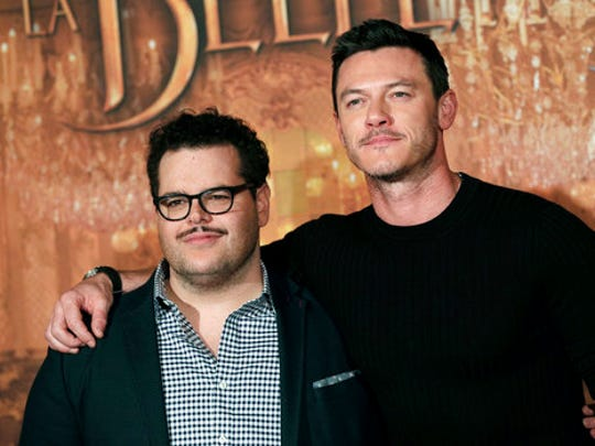 "FILE - In this Feb. 20, 2017, file photo, actor Josh Gad, left, who plays manservant LeFou and Luke Evans who plays villain Gaston, pose during a promotional event for the movie ""Beauty and the Beast"", in Paris. Walt Disney has shelved the release of its new movie ""Beauty and the Beast"" in mainly Muslim Malaysia, even though film censors said Tuesday, March 14, 2017, it had been approved with a minor cut involving a ""gay moment"" between two characters in the film."