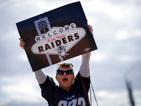 Labor union member Geraldine Lacy celebrates Monday, March 27, 2017, in Las Vegas. NFL team owners approved the move of the Raiders to Las Vegas in a vote at an NFL football annual meeting in Phoenix.