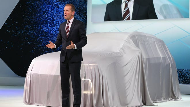 Herbert Diess, CEO of Volkswagen's passenger cars unit, apologizes for the emissions scandal in Tokyo on Oct. 28.
