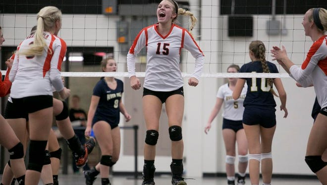 Marshfield's Alexa Aumann celebrates a point against River Falls during the Division 1 volleyball sectional semifinal playoff game at Marshfield High School, Thursday.