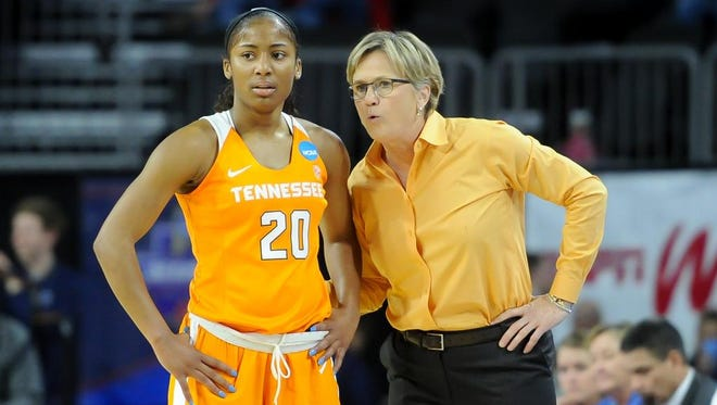 Tennessee coach Holly Warlick talks with guard Te'a Cooper (20) during a break against Ohio State in the second half.
