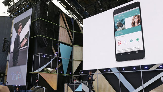 Google CEO Sundar Pichai delivers the keynote address of the Google I/O conference Wednesday, May 18, 2016, in Mountain View, Calif. Google unveiled its vision for phones, cars, virtual reality and more during its annual conference for software developers.
