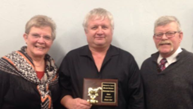 Richard Julka (center) is the recipient of the Fond du Lac County Holstein Association's Service Award. The award was presented by Rae Nell and Ray Halbur.