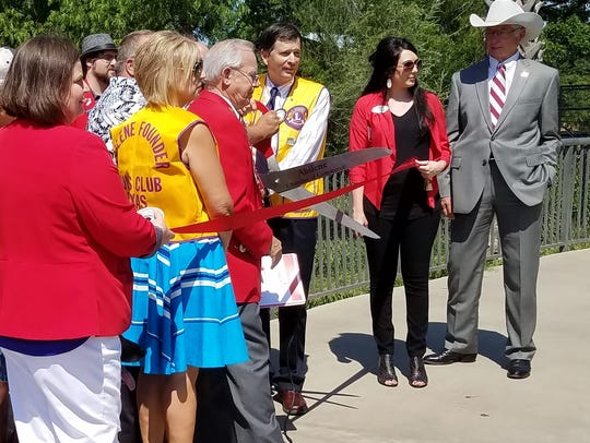 Abilene Founder Lions Club president Jeff Eckard cuts
