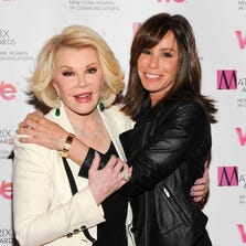"FILE - In this April 22, 2013 file photo, Television personalities Joan Rivers, left, and daughter Melissa Rivers attend the 2013 Matrix New York Women in Communications Awards at the Waldorf-Astoria Hotel, in New York. Attorneys for two women held in a Cleveland home and abused for a decade say Joan Rivers should apologize for comparing living in her daughter's guest room with the captivity they experienced. Rivers and her daughter were discussing their reality show Tuesday, April 22, 2014, on NBC's ""Today"" show when she complained about her living arrangements, saying, ""Those women in the basement in Cleveland had more space."" (Photo by Evan Agostini/Invision/AP, file) ORG XMIT: CAET355"