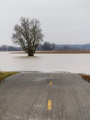A section of Duesner Road is flooded in the Union Township