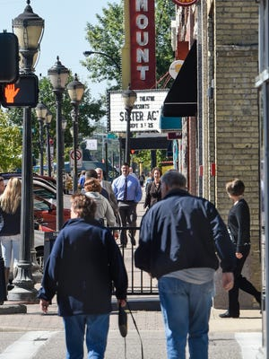 People walk along St. Germain Street Wednesday, Sept. 14, in St. Cloud. Recently-released survey estimates from the U.S. Census Bureau show income and poverty rates relatively unchanged, while costs for apartment rental are rising due to high demand.