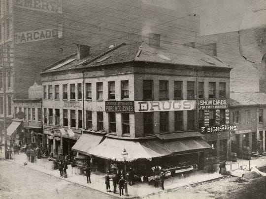 """The southwest corner of Fifth and Vine in 1880 was notorious as the """"Nasty Corner,"""" flush with saloons giving away a """"wienerwurst with each drink."""" J.T. Carew, co-founder of Mabley & Carew, fulfilled a vow to clean up the corner with the  Carew Building in 1891, which was replaced by Carew Tower in 1930."""