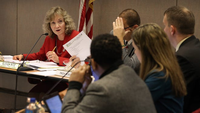 Glenda Ritz, superintendent of public instruction, is shown meeting with other of the State Board of Education at a meeting in December 2013 at the Indiana Government Center.