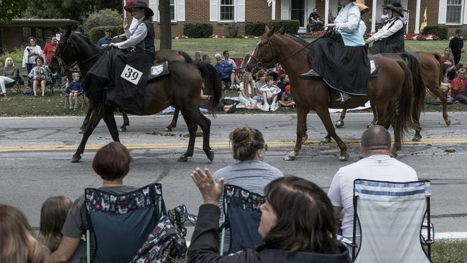 Delaware residents watch the horses pass by during last year's All Horse Parade. This year's parade has been canceled due to the COVID-19 coronavirus pandemic.
