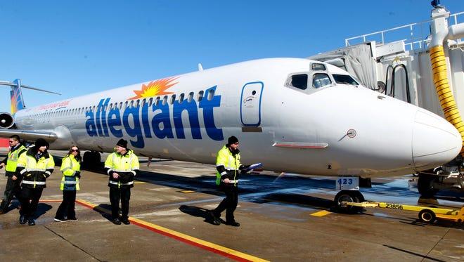 Ground crew members prepare an Allegiant Air jet for departure at CVG.  departure.