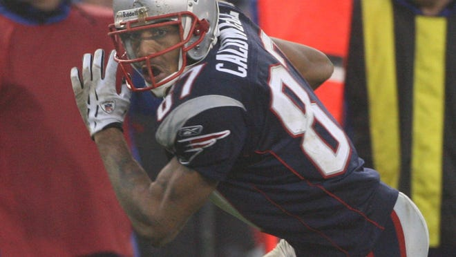 Reche Caldwell, Patriots wide receiver, runs for a touchdown after a fourth-quarter reception against the Jets in a game in 2006.