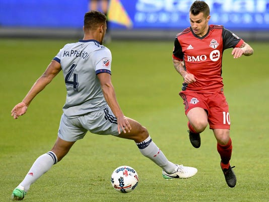Chicago Fire defender Johan Kappelhof (4) tries for the tackle on Toronto FC forward Sebastian Giovinco (10) during the first half of an MLS soccer match in Toronto on Friday, April 21, 2017. (Frank Gunn/The Canadian Press via AP)