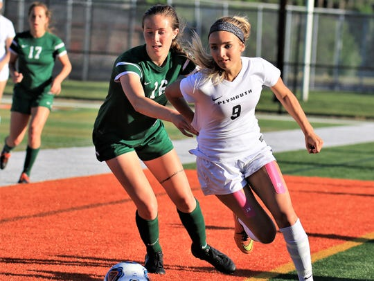 Plymouth's Alexis White (9) gains a step on Novi's