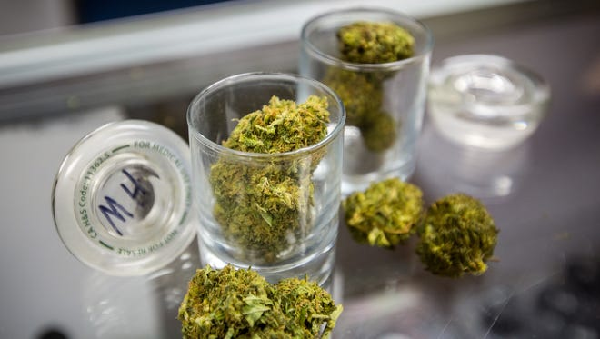 """A strain marijuana labeled as """"Maui Haze"""" available for sale at the Mother Earth Herbs medical marijuana dispensary in Las Cruces, June 16, 2016."""