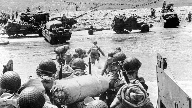 FOR USE ANYTIME WITH D-DAY STORIES--FILE--American soldiers land on the French coast of Normandy during the D-Day invasion in June 1944. (AP Photo/Files-Wartime Pool)