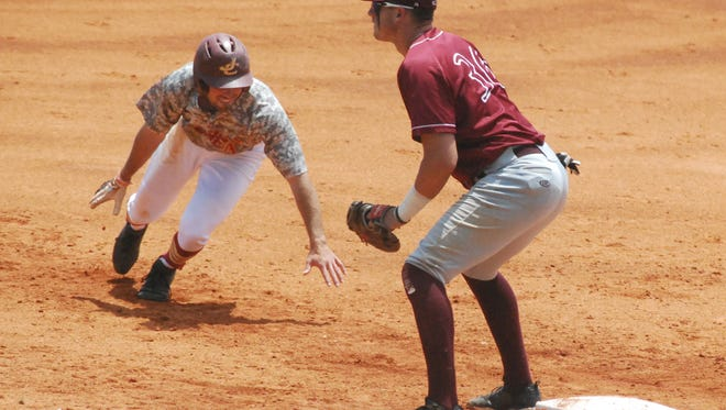 JCJC's Trace Henry (3) heads back to first base as Hinds' Staton Todd (36) waits on the throw.
