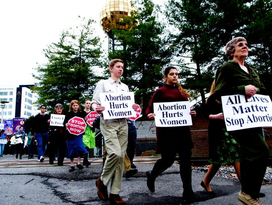 Attendees march during a pro-life march in Knoxville,