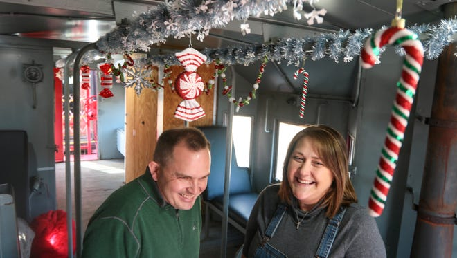 Steven and Cheryl Hawkins, of Greenville & Western Railway Company,  prepare for the Santa Express in Belton. The train, which makes four stops from Belton to Pelzer, is having in its 10th year of making stops in Anderson County with Santa Claus aboard.