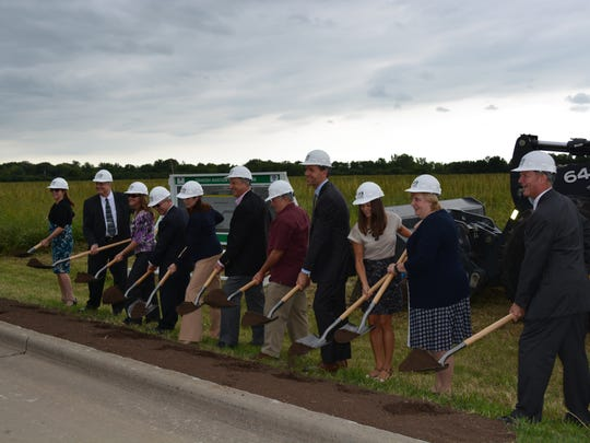 Officials attend a groundbreaking ceremony for the Oshkosh Aviation Business Park in 2014.