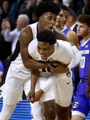 David Duke, back, A.J. Reeves and the Providence Friars were flying high entering the Big East Tournament before the coronavirus pandemic ended the season early.