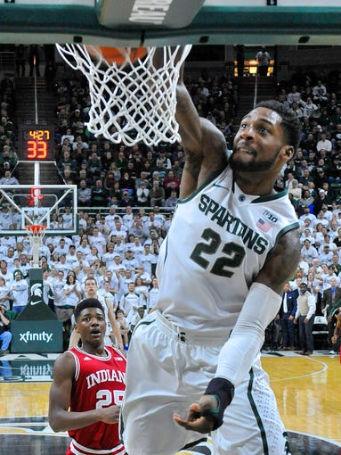 Spartan Branden Dawson slams the ball through the basket