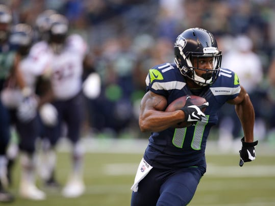 Seattle Seahawks' Percy Harvin runs against the Chicago Bears in the first half of an preseason NFL football game, Friday, Aug. 22, 2014, in Seattle. (AP Photo/Stephen Brashear)
