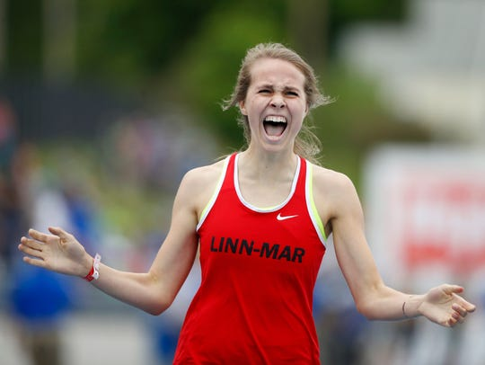 Linn-Mar's Payton Wensel celebrates as she wins the