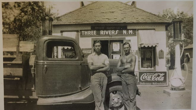 Wayland Hill and an unidentified CCC buddy, take a break from a CCC dam construction assignment at Three Rivers. The pair posed in front of a 1935 Ford model.