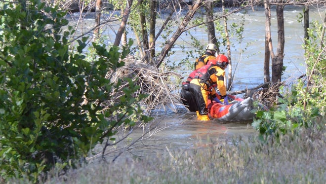 Authorities respond to a report of a body found in the Truckee River at Brohead Memorial Park on June 6, 2017.