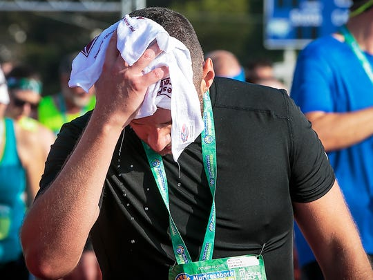 John Neely welcomed a cool towel as he finished the 2017 Murfreesboro Half Marathon.