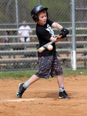 Emerson Autrey makes solid contact with a ball in an