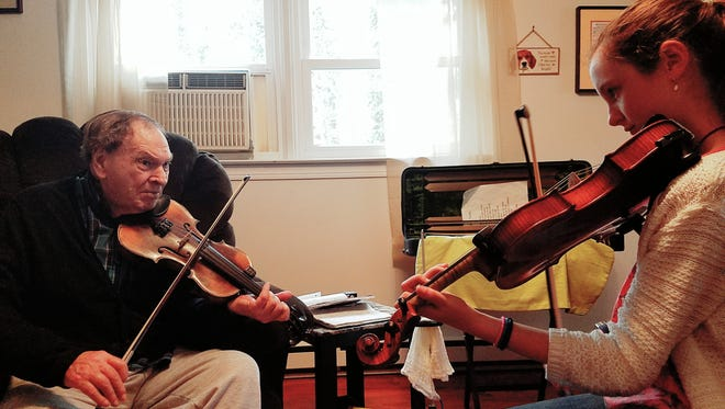 North Carolina Heritage Award winner Arvil Freeman has shared vast knowledge and skills with generations of students including Lillian Chase. Both are set to perform March 14 at the annual Fiddlers of Madison County fundraiser benefiting the Madison County Arts Council.