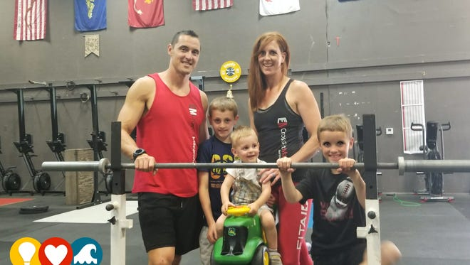 Matt and Audrey DiMarco and their three sons, Roman, Titusand Solomon.Matt and Audrey are owners of CrossFit Manitowoc.