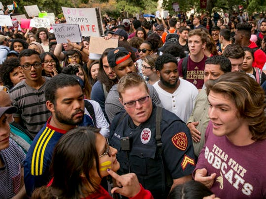 Protester Patricia Romo, left, 22, argues with Trump supporter Cody Williams, 18, during a demonstration at Texas State University in San Marcos, Texas, Thursday Nov. 10, 2016, opposition of Donald Trump's presidential election victory.