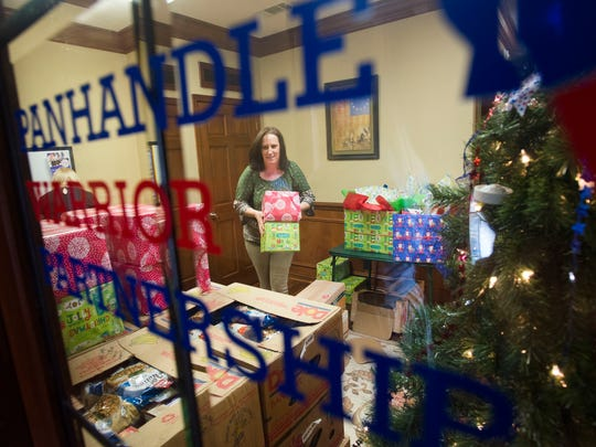 Samantha Barrett, from the organization Panhandle Warrior Partnership, works to finish food boxes for in need military veterans just in time for the holidays.