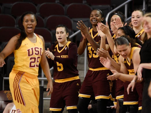 Players on the Arizona State bench applaud during the