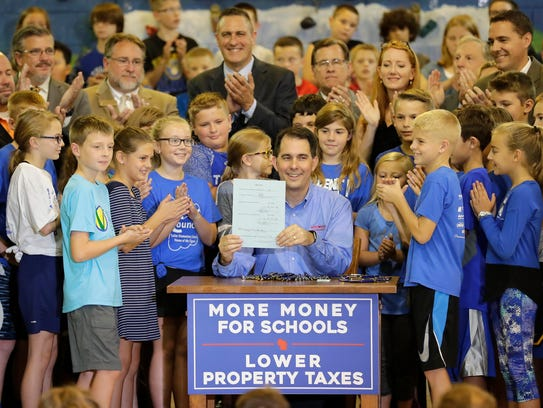 Gov. Walker poses with Neenah student after signing