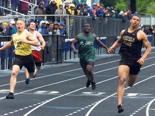 Garfield's Mile Austin winning 100, (Paramus Catholic's Anthony Cinelli,left, was second) at the Bergen County Track and Field Championships Sat., May 18, 2002 at Teaneck.