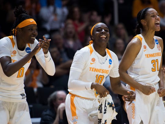 Tennessee's Rennia Davis (0), Tennessee's Meme Jackson (10), and Tennessee's Jaime Nared (31) yell from the bench during the women's NCAA Tournament first round game between Tennessee and Liberty at Thompson-Boling Arena Friday, March 16, 2018.