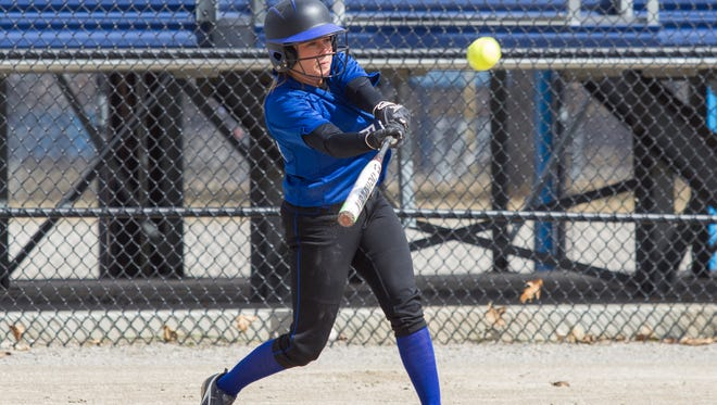 Tess Gailhouse of Kellogg Community College gets a hit against Grand Rapids Community College.