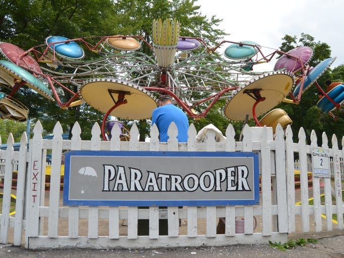 The Paratrooper ride takes thrillseekers on a spinning journey into the sky. It was initially installed inside Conneaut Lake Park in the 1960s. Photo taken July 20, 2014.