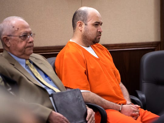 Defense attorney James Lawrence (left) and Arturo Garza,