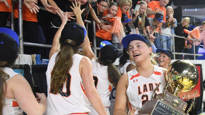 Greenfield's Anna Dale Wright carries the 2018 Class A Championship Trophy after the Lady Jackets defeated Summertown, 47-39, Saturday, March 10, in Murfreesboro.